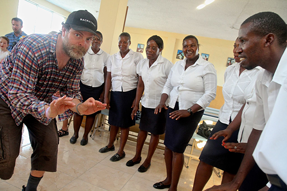 Fig. 6: Actor Rainn Wilson, in action in Haiti with LIDE. Photo: Nadia Todres.